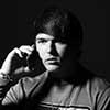 Black and white photo of upset man talking on phone