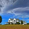 Farm home with clouds
