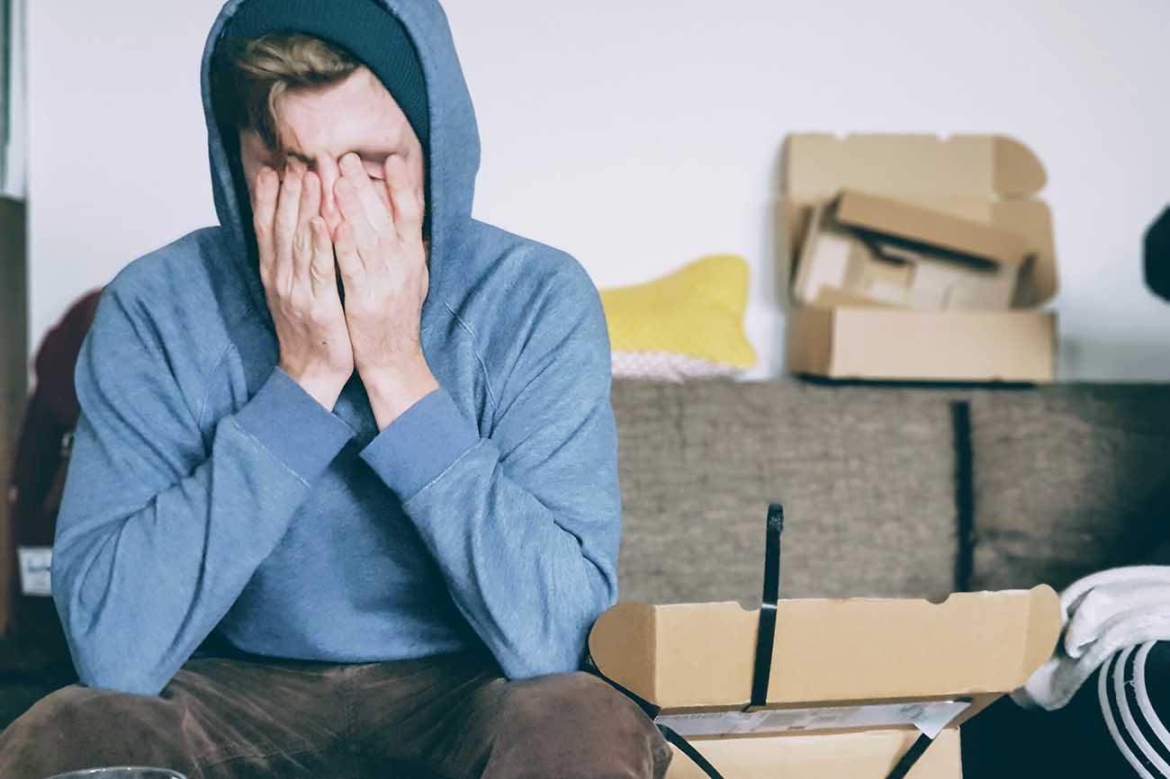 frustrated man in hoodie