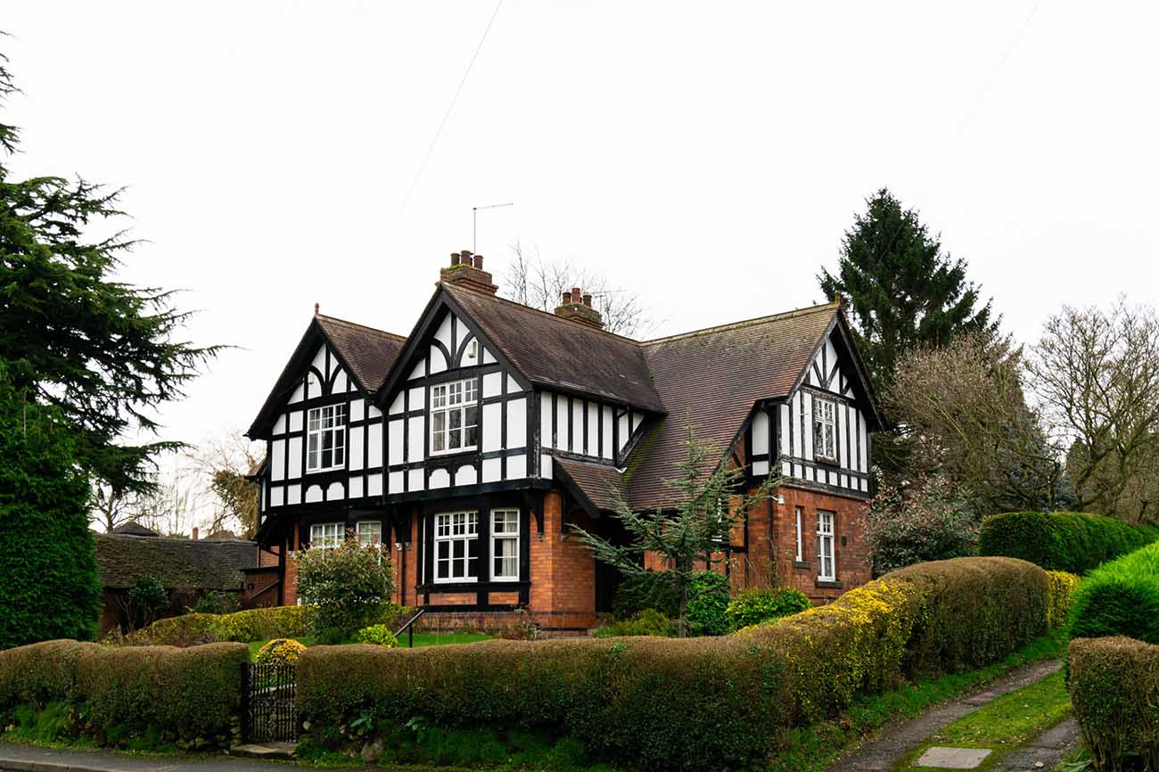 White and red brick tudor house