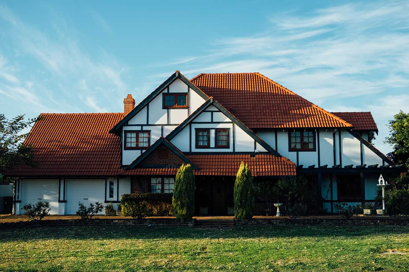 Tudor home with red tile roof