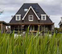 Tudor home with grass