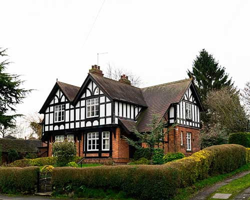 White and red brick tudor house