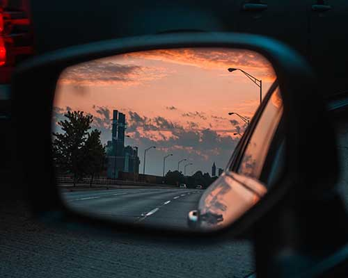 Side mirror of car with road