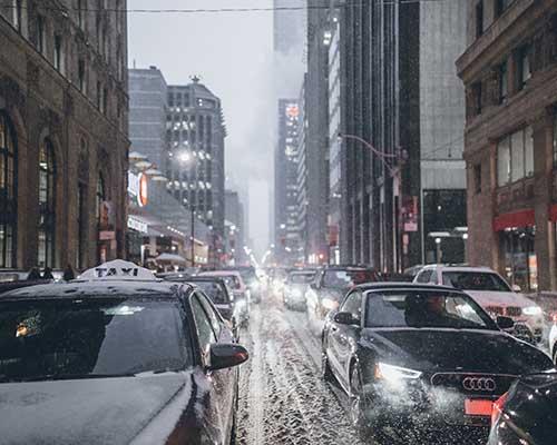 Winter traffic on slushy city road
