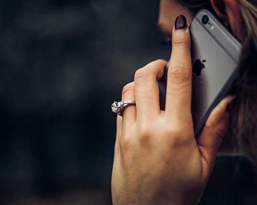 woman talking on iPhone