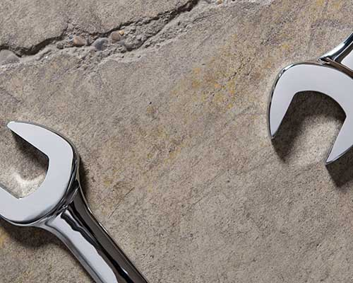 Wrenches on concrete