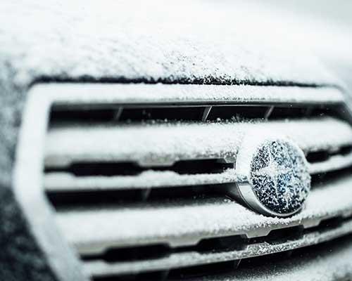 Snowy Subaru grille