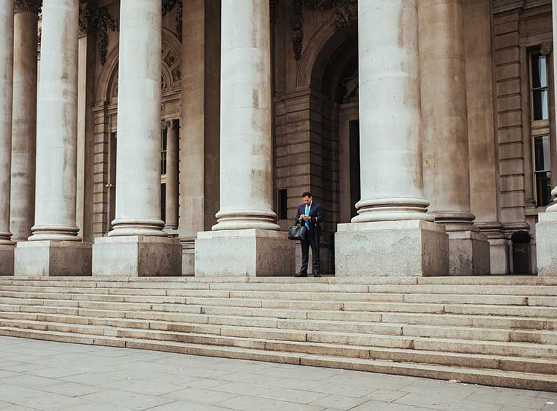 man walking out of government building